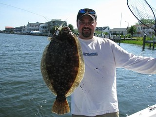 Photo of man holding a flounder