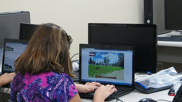 A student playing one of the 7 Generation Games